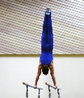 gymnast in control on bars